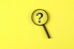 Question mark magnifying glass B2B PR